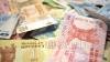 Leul pierde teren în raport cu moneda unică europeană
