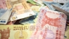 Cursul valutar: Leul continuă să piardă teren în raport cu moneda unică europeană