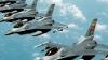 Atacuri aeriene ale Coaliţiei internaţionale. 10 vehicule ale grupării Statului Islamic au fost distruse