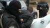 Descindere cu mascaţi! O grupare criminală periculoasă, deconspirată de oamenii legii (VIDEO)