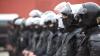 Descindere în forţă cu mascaţi! Membrii unei grupări, reţinuţi pentru omor intenţionat (VIDEO)
