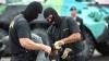 Operaţiune internaţională. Poliţia anunţă detalii despre descinderile cu mascaţi