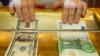 EURO şi DOLARUL continuă să crească. Cursul oficial stabilit de BNM