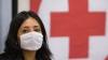 Simptomele gripei AH1N1. Ce trebuie să ştiţi pentru a evita contactul cu boala