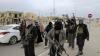 EXOD în Irak. Zeci de mii de oameni au părăsit un oraș atacat de jihadiști (FOTOREPORT)