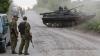 Un CIVIL a murit în luptele din estul Ucrainei. Insurgenţii proruşi folosesc armament greu