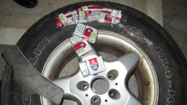 """Cauciucuri """"umflate"""" cu ţigări de contrabandă. Isprava unu cetăţean român care a fost prin Moldova"""