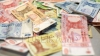 Specialişti în falsificarea banilor! 11 cetăţeni moldoveni şi români, cercetaţi penal