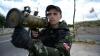 O localitate din Lugansk a fost atacată cu tehnică militară grea. Sunt morţi şi răniţi