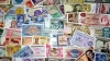 Războiul valutar din lume ar putea afecta monedele naţionale din ACESTE ţări