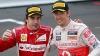 Fanii japonezi i-au întâmpinat cu aplauze pe Jenson Button şi Fernando Alonso