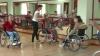 Oameni cu dizabilităţi încing dansuri. Proiect de caritate la Ungheni