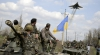 Va fi pace? Trupele ucrainene au început să-şi retragă armamentul din Lugansk