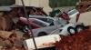 Pagube de sute de mii de dolari! O duzină de maşini a căzut într-o groapă gigantică (VIDEO)