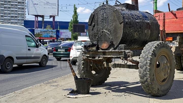 POZA ZILEI! Rezultatul muncitorilor care au asfaltat o parcare (FOTO)