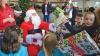 SĂRBĂTOARE pe peronul gării! Copiii care au ciruclat cu trenul au primit daruri de la Moş Crăciun