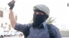 """""""OFIŢERII DE POLIŢIE ISIS"""": Terorişti în uniforme albastre şi măşti patrulează un oraş libian (VIDEO)"""