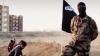 OROARE JIHADISTĂ! Momentul în care teroriștii ISIS aruncă în aer doi prizonieri (VIDEO 18+)