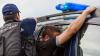 Doi bărbați, reținuți în flagrant. Ce făceau în mașina unui angajat al Aeroportului Chișinău