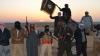 ÎNFRICOȘĂTOR! Un jihadist, imobilizat într-un scaun cu rotile, execută un spion din Libia (FOTO)