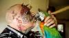 Nebunia oamenilor NU ARE LIMITE! Un bărbat şi-a făcut operaţii estetice pentru a arăta ca un papagal (FOTO)