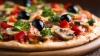PREMIERĂ MONDIALĂ! Pizza la domiciliu va fi livrată de roboți (FOTO/VIDEO)
