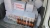 Business moldovenesc! Sute de sticle de votcă şi coniac de contrabandă urmau să fie vândute la piaţă