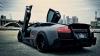 Un Lamborghini Murcielago se transformă în bilă de flipper pe o autostradă udă (VIDEO)