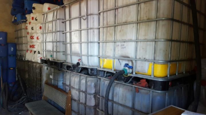 Evaziune de aproape trei milioane de lei la o fabrică de producere a alcoolului (VIDEO)