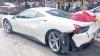 Două mașini Ferrari ultimul răcnet au fost distruse din cauza unui maidanez
