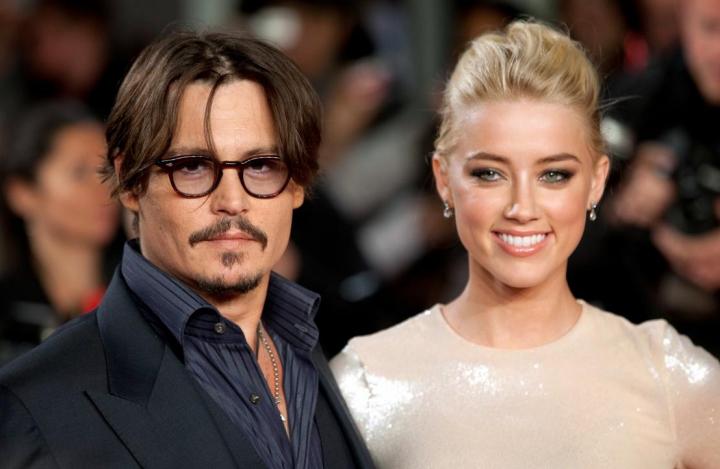 Johnny Depp a fost filmat când își bătea nevasta (Video)