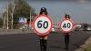 INEDIT! Polițiste topless poartă limitatoare de viteză pentru siguranța rutieră (VIDEO)
