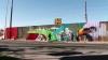 Mesaj de unitate! Mexicanii promovează pacea printr-un graffiti desenat pe un zid de la granița cu SUA