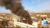 FUM NEGRU deasupra Capitalei. Tot oraşul miroase a plastic ars (GALERIE FOTO)