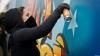 Chişinăul prinde culoare! Un grup de pictori îşi aştern fantezia pe zidurile unui stadion din Capitală
