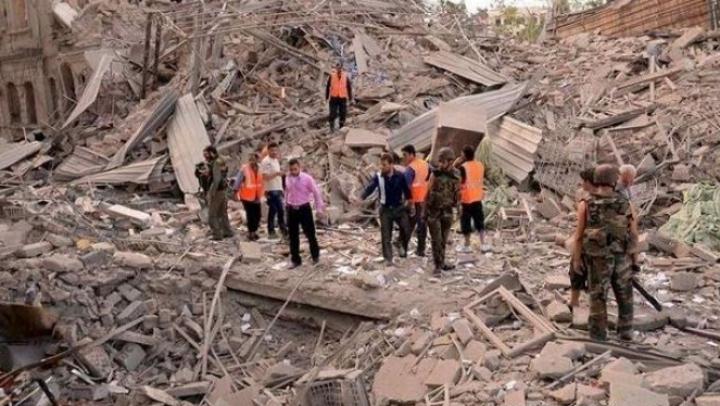 Salvare dramatică! Un copil, scos din ruinele unei clădiri distruse de bombardament