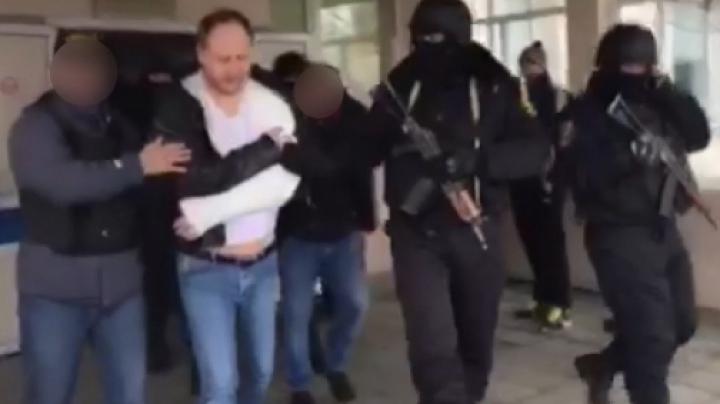 MOMENTUL în care Vitalie Burlacu, principalul figurant în dosarul coruperii deputaților, este reţinut (VIDEO)
