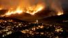 GROAZNIC! Peste 100 de case au ars din temelie. Mai mulţi localnici, evacuaţi de urgenţă