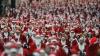 Madridul s-a deghizat în roșu! Sute de Moși Crăciuni au alergat în scop caritabil (VIDEO)