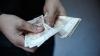 Politica bugetar-fiscală, aprobată. Moldovenii vor putea păstra, de anul viitor, mai mulţi bani din salariu