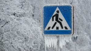 """Un indicator rutier """"a leşinat de frig"""". MOMENT AMUZANT, surprins în Capitală (VIDEO)"""