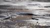 Dezastru în urma ploilor torențiale. Zeci de gropi, formate pe străzile Capitalei