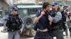 Zeci de evrei ultraortodocși au fost arestați în urma unor demonstrații violente