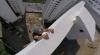 TERIFIANT! Un tânăr stă agățat de un zgârie-nori pentru a se antrena (VIDEO AMEŢITOR)
