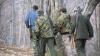 Doi bărbaţi au fost reţinuţi pentru vânătoare ilegală de mistreţi