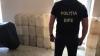 """Vindeau alcool contrafăcut într-un depozit de lângă Chişinău. Nouă """"afacerişti"""", reţinuţi de poliţie"""