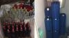 Comercializau alcool contrafăcut în cantităţi foarte mari: Doi bărbați, reținuți (VIDEO)
