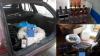 Percheziții la domicilii: 12 bărbaţi vindeau ilegal alcool pe internet (VIDEO)