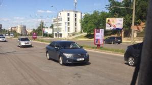 Iresponsabilitatea unui tată. Cum a fost surprins un şofer în Capitală (FOTO)
