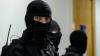 Percheziţii la Drochia şi Chişinău. Un fost poliţist reţinut într-un dosar de corupţie